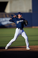 AZL Brewers Blue shortstop Cam Devanney (2) throws to first base during an Arizona League game against the AZL Athletics Gold on July 2, 2019 at American Family Fields of Phoenix in Phoenix, Arizona. AZL Athletics Gold defeated the AZL Brewers Blue 11-8. (Zachary Lucy/Four Seam Images)