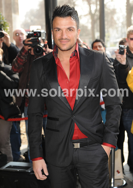 **ALL ROUND PICTURES FROM SOLARPIX.COM**                                             **WORLDWIDE SYNDICATION RIGHTS**                                                                                  Outside arrivals at the TRIC Awards 2011.  Held at Grosvenor House, Park Lane, London, on Tuesday March 08, 2011                                                                         This pic:     Peter Andre                                                                                       JOB REF:    12940    SSD       DATE:    08.03.11                                                        **MUST CREDIT SOLARPIX.COM OR DOUBLE FEE WILL BE CHARGED**                                                                      **MUST AGREE FEE BEFORE ONLINE USAGE**                               **CALL US ON: +34 952 811 768 or LOW RATE FROM UK 0844 617 7637**