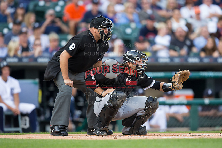 Chicago White Sox catcher Kevan Smith (36) sets a target as home plate umpire Mark Carlson looks on during the game against the Detroit Tigers at Comerica Park on June 2, 2017 in Detroit, Michigan.  The Tigers defeated the White Sox 15-5.  (Brian Westerholt/Four Seam Images)