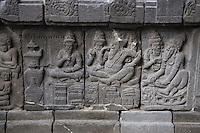 Yogyakarta, Java, Indonesia.  Prambanan Temples.  Rama Celebrating with Twin Sons.  Wall Carving.