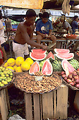 Recife, Brazil. Market stall selling tamarind, limes, apples, melons, water melons.