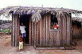 Porto Seguro, Bahia State, Brazil. Pataxo Indian family and their house near Coroa Vermelha.