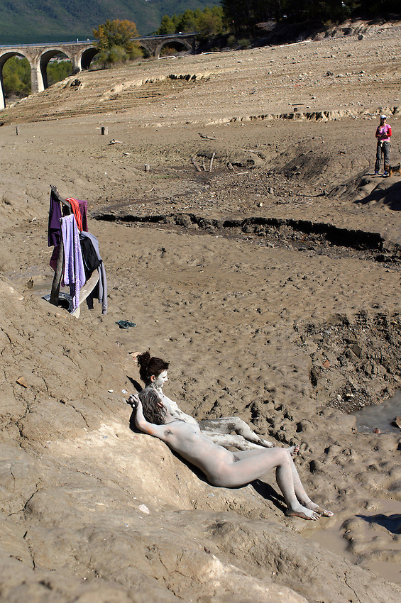 People repose in the ancient Baths of sulphurous waters of Tiermas on October 13, 2012, in the Spanish reservoir of Yesa. The ancient baths of sulphurous waters of Tiermas are under Yesa reservoir waters and return to the surface when the reservoir is running low on water.  Photo: Ander Gillenea