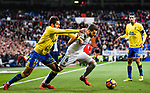 Nacho Fernandez of Real Madrid (C) fights for the ball with Pedro Bigas Rigo of UD Las Palmas (L)  during the La Liga 2017-18 match between Real Madrid and UD Las Palmas at Estadio Santiago Bernabeu on November 05 2017 in Madrid, Spain. Photo by Diego Gonzalez / Power Sport Images