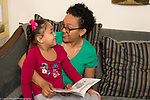 4 year old girl with mother, read to, interacton