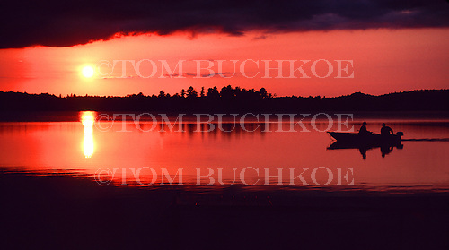 Boaters at sunset on Lake Ruth in Upper Peninsula of Michigan.