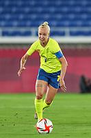 YOKOHAMA, JAPAN - AUGUST 6: Captain Caroline Seger #17 of Sweden goes forward during a game between Canada and Sweden at International Stadium Yokohama on August 6, 2021 in Yokohama, Japan.