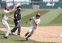 Arkansas infielder Robert Moore (1) runs home for a score, Saturday, April 3, 2021 during the sixth inning of a baseball game at Baum-Walker Stadium in Fayetteville. Check out nwaonline.com/210404Daily/ for today's photo gallery. <br /> (NWA Democrat-Gazette/Charlie Kaijo)
