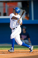 Geulin Beltre #2 of the Burlington Royals follows through on his swing versus the Elizabethton Twins at Burlington Athletic Park July 19, 2009 in Burlington, North Carolina. (Photo by Brian Westerholt / Four Seam Images)