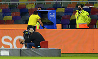 3rd June 2021; Estadio Único de Santiago del Estero, Santiago del Estero, Argentina; World Cup football qualification, Argentina versus Chile; Referee Jesus Valenzuela checks the VAR for legitimacy of the Chile equaliser