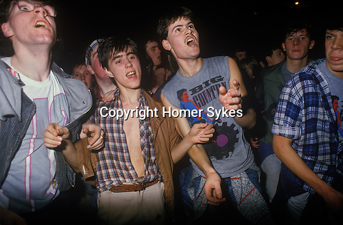 Pop Concert 1980s live performance gig in Glasgow. Fans screaming at a pop music concert. Pop group are called Big Country on tour Scotland 80s