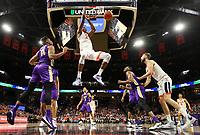 Virginia forward Mamadi Diakite (25) dunks the ball between James Madison defenders during an NCAA college basketball game in Charlottesville, Va., Sunday, Nov. 10, 2019. Virginia won 65-34. (AP Photo/Andrew Shurtleff)