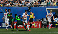 GRENOBLE, FRANCE - JUNE 22: Lina Magull #20 of the German National Team passes the ball as Halimatu Ayinde #18 of the Nigerian National Team defends during a game between Nigeria and Germany at Stade des Alpes on June 22, 2019 in Grenoble, France.