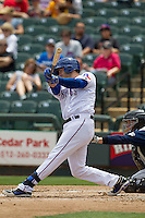 Round Rock Express third baseman Mike Olt #20 swings the bat against the New Orleans Zephyrs in the Pacific Coast League baseball game on April 21, 2013 at the Dell Diamond in Round Rock, Texas. Round Rock defeated New Orleans 7-1. (Andrew Woolley/Four Seam Images).