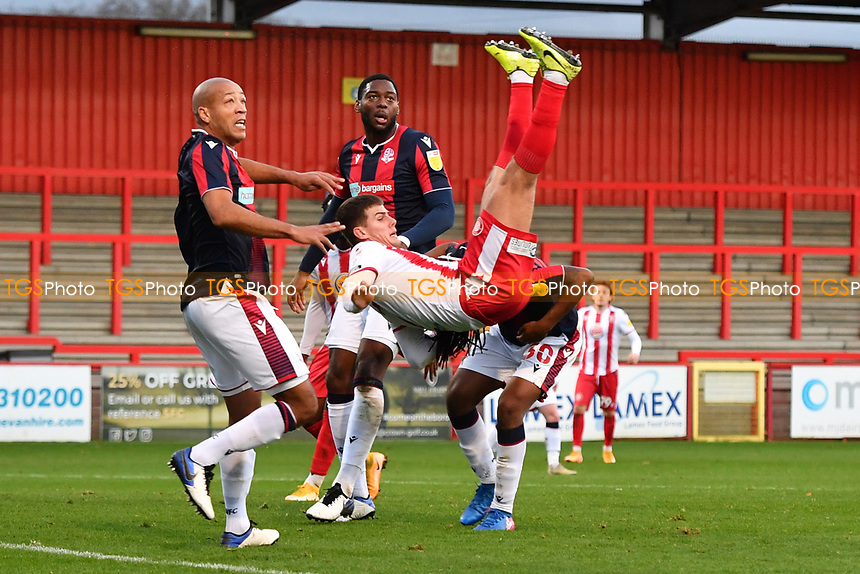 Charlie Carter of Stevenage FC flies throw the air  during Stevenage vs Bolton Wanderers, Sky Bet EFL League 2 Football at the Lamex Stadium on 21st November 2020