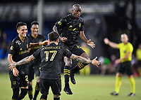 LAKE BUENA VISTA, FL - JULY 18: Bradley Wright-Phillips #66 of LAFC celebrates his goal with teammates Eduard Atuesta #20 and Brian Rodríguez #17 during a game between Los Angeles Galaxy and Los Angeles FC at ESPN Wide World of Sports on July 18, 2020 in Lake Buena Vista, Florida.