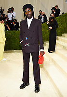 """Dev Hynes attends The Metropolitan Museum of Art's Costume Institute benefit gala celebrating the opening of the """"In America: A Lexicon of Fashion"""" exhibition on Monday, Sept. 13, 2021, in New York. (Photo by Evan Agostini/Invision/AP)"""