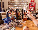 November 27, 2019. Cary, North Carolina.<br /> <br /> Jimmy Mahan produces videos for Instagram and YouTube that highlight newly acquired items. <br /> <br /> Jimmy Mahan, a former social worker and banker, has a massive collection of sports memorabilia. His collection spans his days as a kid growing up in Kentucky and loving UK basketball all the way through high collectible classic baseball cards, jerseys and sneakers.