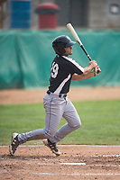 Grand Junction Rockies third baseman Coco Montes (19) follows through on his swing during a Pioneer League game against the Helena Brewers at Kindrick Legion Field on August 19, 2018 in Helena, Montana. The Grand Junction Rockies defeated the Helena Brewers by a score of 6-1. (Zachary Lucy/Four Seam Images)