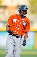 Henry Urrutia (51) of the Norfolk Tides hustles around the bases during the game against the Charlotte Knights at BB&T BallPark on April 20, 2016 in Charlotte, North Carolina.  The Knights defeated the Tides 6-3.  (Brian Westerholt/Four Seam Images)