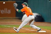 Miami Hurricanes first baseman Peter O'Brien #7 stretches for a throw during the game against the Wake Forest Demon Deacons at NewBridge Bank Park on May 25, 2012 in Winston-Salem, North Carolina.  The Hurricanes defeated the Demon Deacons 6-3.  (Brian Westerholt/Four Seam Images)