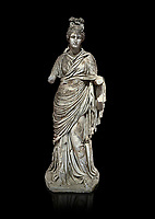 Roman statue of a woman. Marble. Perge. 2nd century AD. Inv no 2015/186. Antalya Archaeology Museum; Turkey. Against a black background.