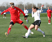 Rebecca Moros #19 of the Washington Freedom tackles Lyndsey Patterson #16 of the Philadelphia Independence during a WPS pre season match at the Maryland Soccerplex on March 27 2010 in Boyds, Maryland. The game ended in a 0-0 tie.