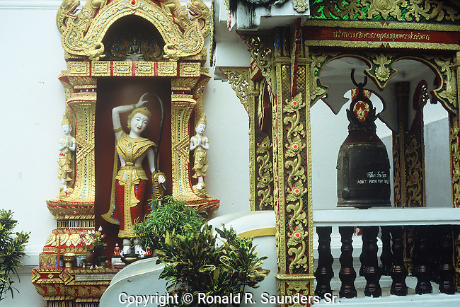 """Wat Phra That Doi Suthep (Thai: วัดพระธาตุดอยสุเทพ, Thai pronunciation: [wát.pʰráʔ.tʰâat.dɔɔj.sùʔ.tʰêep], Northern Thai pronunciation: [wa̋t.pʰa̋ʔ.tʰâat.dɔɔj.súʔ.têep]) is a Theravada Buddhist temple in Chiang Mai Province, Thailand. The temple is often referred to as """"Doi Suthep"""" although this is actually the name of the mountain it is located on. The temple is located 15 kilometres (9.3 mi) from the city of Chiang Mai and is a sacred site to many Thai people. From the temple, impressive views of Chiang Mai can be seen and it remains a popular destination for tourists.CHIANG MAI"""
