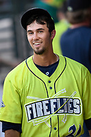 Center fielder Jacon Zanon (21) of the Columbia Fireflies smiles after scoring a run in a game against the Augusta GreenJackets on Saturday, July 29, 2017, at Spirit Communications Park in Columbia, South Carolina. Columbia won, 3-0. (Tom Priddy/Four Seam Images)