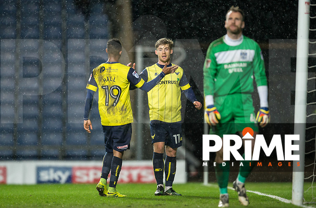 Everton Loanee Conor McAleny of Oxford United celebrates his hattrick with Rob Hall of Oxford United as Goalkeeper Joe Murphy of Bury looks downbeat during the Sky Bet League 1 match between Oxford United and Bury at the Kassam Stadium, Oxford, England on 28 March 2017. Photo by Andy Rowland / PRiME Media Images.