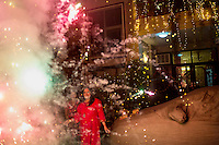 People set off fireworks in the street on the occasion of Diwali, one of the biggest festival for Hindus.