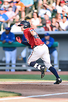 Mississippi Braves left fielder Dustin Peterson (28) runs to first during a game against the Tennessee Smokies at Smokies Stadium on May 7, 2016 in Kodak, Tennessee. The Smokies defeated the Braves 5-3. (Tony Farlow/Four Seam Images)