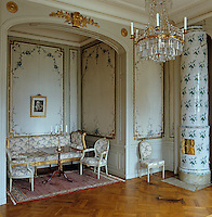 The bedroom of Baroness Ottiliana Liljencrantz features murals by Lars Bolander and a Gustavian sofa and chairs in the alcove where the bed would once have stood