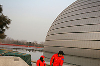 CHINA. Beijing. Outside view of the Grand National Theatre. Designed by French architect Paul Andreu, The Grand National Theatre is located near Beijing's central Tian'anmen Square. It is an enormous glass and titanium tear-drop-like bubble structure surrounded by water. As China's top art performance center, it covers a total floor space of around 180,000 square meters, including 130,000 square meters for the main building and 50,000 square meters underground facilities. 2008.