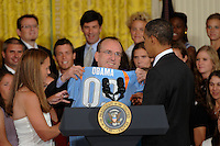 Sky Blue President and CEO Thomas Hofstetter and Christie Rampone present President Barack Obama with a team jersey as he welcomes the reigning Women's Professional Soccer (WPS) champions to the East Room of the White House in Washington, D. C., on July 01, 2010.