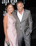 Kevin Costner and Christine Baumgartner attends TheParamount Pictures' L.A. Premiere of Jack Ryan : Shadow Recruit held at The Chinese Theatre in Hollywood, California on January 15,2014                                                                               © 2014 Hollywood Press Agency