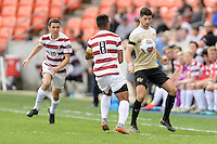 Houston, TX - Friday December 11, 2016: Jon Bakero (7) of the Wake Forest Demon Deacons gains control of a loose ball against the Stanford Cardinal at the NCAA Men's Soccer Finals at BBVA Compass Stadium in Houston Texas.