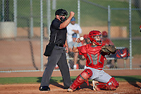 Home plate umpire Luke Morris calls a strike on a batter behind catcher Edwin Bisay (5) during a game between the AZL Angels and AZL Giants Orange at Giants Baseball Complex on June 17, 2019 in Scottsdale, Arizona. AZL Giants Orange defeated AZL Angels 8-4. (Zachary Lucy/Four Seam Images)