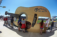 Fans watch the International League game between the Durham Bulls and the Lehigh Valley Iron Pigs through a giant Martin & Co. guitar on the concourse in center field at Coca-Cola Park on July 30, 2017 in Allentown, Pennsylvania.  The Bulls defeated the IronPigs 8-2.  (Brian Westerholt/Four Seam Images)