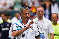 Real Madrid manager Jose Mourinho waves to fans as he takes the field for warmups prior to playing Celtic F. C. during a 2012 Herbalife World Football Challenge match at Lincoln Financial Field in Philadelphia, PA, on August 11, 2012.