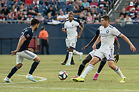 FOXBOROUGH, MA - JULY 27:  Dillon Powers #5 passes the ball as Carles Gil #22 advances at Gillette Stadium on July 27, 2019 in Foxborough, Massachusetts.