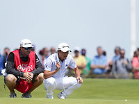 16th July 2021; Royal St Georges Golf Club, Sandwich, Kent, England; The Open Championship Tour Golf, Day Two; Collin Morikawa (USA) studies the line of his putt for par on the 15th green
