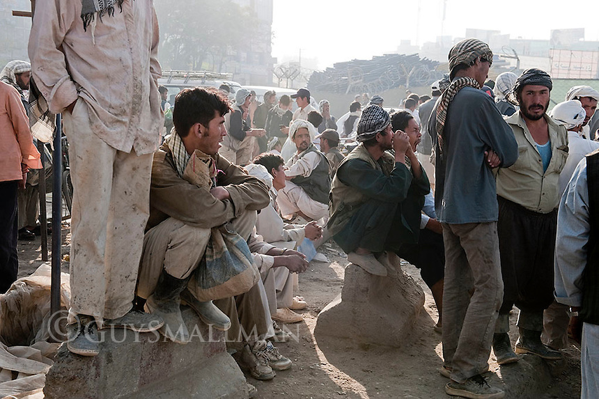 Unemployed Afghans wait at the Kowtasangy Interchange in Kabul hoping for a days work labouring.