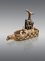 Assyrian Trader Colony Bronze Age terracotta sandal shaped ritual vessed. This cult pot is boat shaped with an animal head at the front. Inside the vessel is a model of a temple and goddess. The deities associated with the ritual vessel were associated with trade and transportation in Ancient Mesopotamia and Summerian literature. The vessel signifies a religious river trip.  - 19th  century BC - Kültepe Kanesh - Museum of Anatolian Civilisations, Ankara, Turkey. Against a grey background.
