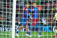 20th September 2021; Nou Camp, Barcelona, Spain; La Liga football league, FC Barcelona versus Granada CF;  Ronald Araujo and Gerard Pique of FC Barcelona celebrate their late equalising goal in minute 90 for 1-1 during the Liga match between FC Barcelona and Granada CF .