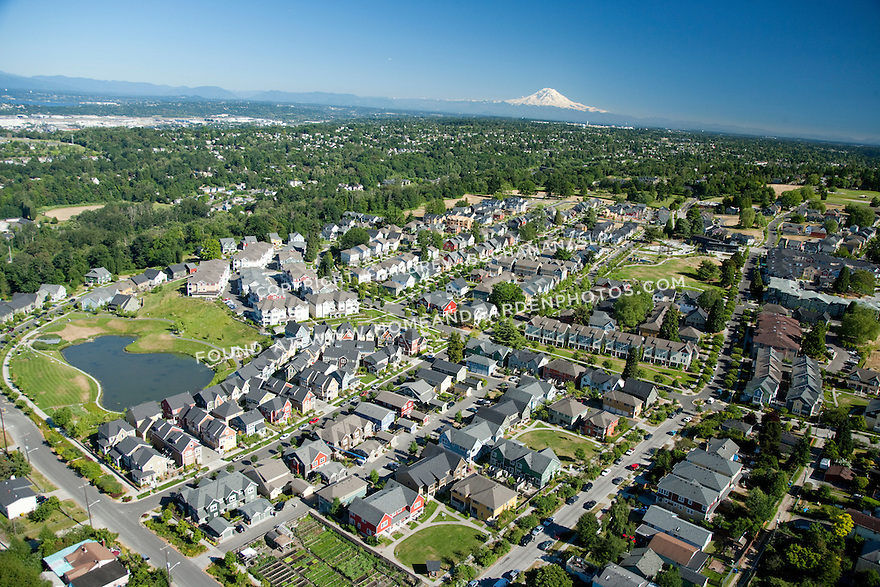 High Point, West Seattle, WA; An aerial view of High Point, a mixed housing development in West Seattle, with Mt. Rainier in the background.