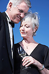 USA, California, Fairfax, Happy mature couple drinking wine on beach