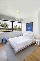 small bedroom with garden view