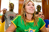 """Brazil fan Tania Machado, as well as a crowd outside, watches their team in a match against Australia on June 18, 2006 at the Emporium, a restaurant in a section of New York City known as """"Little Brazil"""".<br /> <br /> The World Cup, held every four years in different locales, is the world's pre-eminent sports tournament in the world's most popular sport, soccer (or football, as most of the world calls it).  Qualification for the World Cup is open to any country with a national team accredited by FIFA, world soccer's governing body. The first World Cup, organized by FIFA in response to the popularity of the first Olympic Games' soccer tournaments, was held in 1930 in Uruguay and was participated in by 13 nations.    <br /> <br /> As of 2010 there are 208 such teams.  The final field of the World Cup is narrowed down to 32 national teams in the three years preceding the tournament, with each region of the world allotted a specific number of spots.  <br /> <br /> The World Cup is the most widely regularly watched event in the world, with soccer teams being a source of national pride.  In most nations, the whole country is at a standstill when their team is playing in the tournament, everyone's eyes glued to their televisions or their ears to the radio, to see if their team will prevail.  While the United States in general is a conspicuous exception to the grip of World Cup fever there is one city that is a rather large exception to that rule.  In New York City, the most diverse city in a nation of immigrants, the melting pot that is America is on full display as fans of all nations gather in all possible venues to watch their teams and celebrate where they have come from."""
