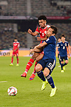 Jameel Al Yahmadi of Oman (L) fights for the ball with Nagatomo Yuto of Japan (R) during the AFC Asian Cup UAE 2019 Group F match between Oman (OMA) and Japan (JPN) at Zayed Sports City Stadium on 13 January 2019 in Abu Dhabi, United Arab Emirates. Photo by Marcio Rodrigo Machado / Power Sport Images